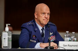 FILE - In this May 6, 2020, file photo Chief of Space Operations at U.S. Space Force Gen.John Raymond testifies before the…