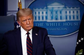 President Donald Trump listens to a question during a briefing with reporters in the James Brady Press Briefing Room of the…