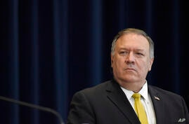 Secretary of State Mike Pompeo listens during a news conference at the State Department in Washington, Wednesday, Aug. 19, 2020…