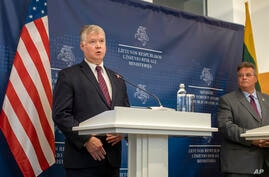 U.S. Deputy Secretary of State Stephen Biegun, left, speaks as Lithuania's Minister of Foreign Affairs Linas Linkevicius…