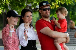 In this photo taken on Sunday, Aug. 2, 2020, Sviatlana Tsikhanouskaya, candidate for the presidential elections, second left,…