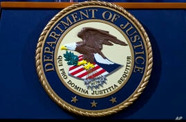 FILE - In this Nov. 28, 2018, file photo, the Department of Justice seal is seen in Washington, D.C. The Justice Department has…