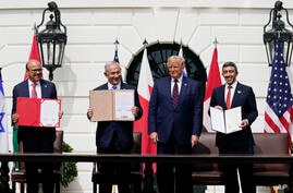 President Donald Trump, center, with from left, Bahrain Foreign Minister Khalid bin Ahmed Al Khalifa, Israeli Prime Minister…