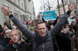 Russian opposition leader Alexei Navalny, centre, attends a rally in Moscow, Russia, Sunday, Jan. 28, 2018. Russian opposition…