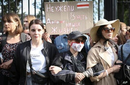 "Belarus students with a banner reading ""Is power more precious than our lives?"", attend a rally in Minsk, Belarus, Tuesday,…"