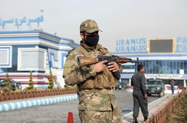 FILE - In this Nov. 21, 2018 file photo, an Afghan security officer stands guard outside a wedding hall in Kabul, Afghanistan…