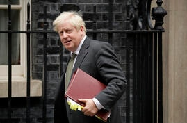 British Prime Minister Boris Johnson leaves 10 Downing Street in London, to attend the weekly Prime Minister's Questions at the…