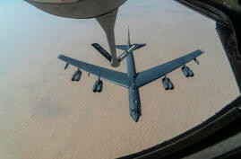 "A U.S. Air Force B-52H ""Stratofortress"" from Minot Air Force Base, N.D., is refueled by a KC-135 ""Stratotanker"" in the U.S…"