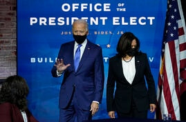 President-elect Joe Biden and Vice President-elect Kamala Harris arrive at an event to introduce their nominees and appointees…