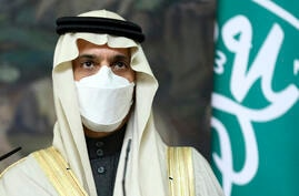 Saudi Foreign Minister Prince Faisal bin Farhan Al-Saud wearing in a face mask to protect himself against coronavirus attend a…