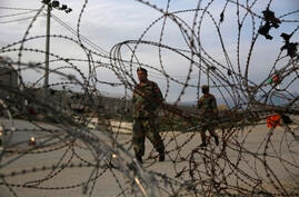 Afghan National Army soldiers stand guard at a checkpoint near the Bagram base in northern Kabul, Afghanistan, Wednesday, April…