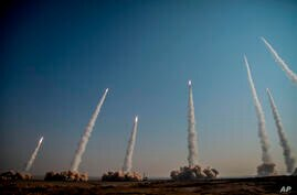 In this photo released on Friday, Jan. 15, 2021, by the Iranian Revolutionary Guard, missiles are launched in a drill in Iran…