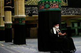 In this picture released by the office of the Iranian supreme leader shows Supreme Leader Ayatollah Ali Khamenei wearing a…