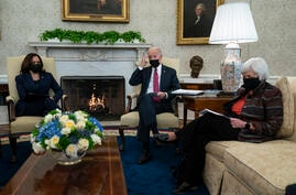 President Joe Biden meets with Treasury Secretary Janet Yellen, right, and Vice President Kamala Harris in the Oval Office of…