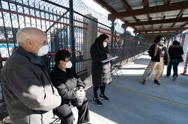 People wait in line to get vaccinated at the Brooklyn Army Terminal, Thursday, Jan. 21, 2021, in New York. Officials say 15 New…