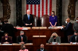Vice President Mike Pence presides over a joint session of Congress as it convenes to count the Electoral College votes cast in…