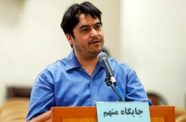 In this June 2, 2020 photo, journalist Ruhollah Zam speaks during his trial at the Revolutionary Court, in Tehran, Iran. Iran…