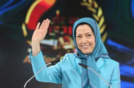 Maryam Rajavi, the leader of the National Council of Resistance of Iran, waves to the audience as she addresses thousands of…