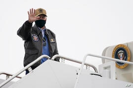 President Joe Biden boards Air Force One at Hagerstown Regional Airport, Monday, Feb. 15, 2021, in Hagerstown, Md., after…