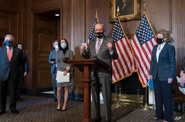 Senate Majority Leader Chuck Schumer, D-N.Y., joined by new chairs of Senate committees, makes a statement as the second…