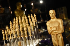Gold-dusted chocolate Oscar statues are pictured at the Governors Ball Press Preview for the 92nd Academy Awards at the Dolby…