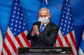 Israeli Prime Minister Benjamin Netanyahu delivers a statement following his meeting with US Secretary of Treasury Steven…
