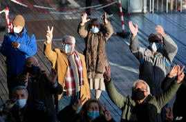 People demonstrate during the trial of four persons, including an Iranian diplomate and Belgian-Iranian couple at the…