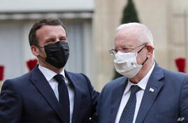French President Emmanuel Macron, left, welcomes Israeli President Reuven Rivlin, prior to a meeting at the Elysee Palace, in…