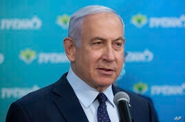 FILE - Israeli Prime Minister Benjamin Netanyahu visits the Leumit Health Care Services vaccination facility and meets Theodor…