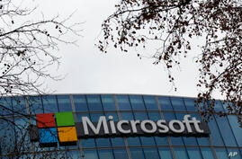 The logo of Microsoft is displayed outside the headquarters, in Paris, Friday, Jan. 8, 2021. (AP Photo/Thibault Camus)
