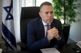 FILE - In this Thursday, Oct. 26, 2017, file photo, Israeli Public Security Minister Gilad Erdan speaks during an interview…