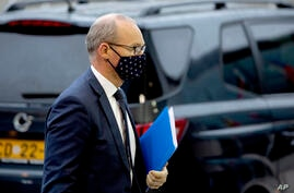 Ireland's Foreign Minister Simon Coveney arrives for a meeting of EU General Affairs ministers at the European Council building…