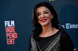"Shohreh Aghdashloo, a cast member and executive producer of ""Simple Wedding,"" poses at the premiere of the film at the 2018 Los…"