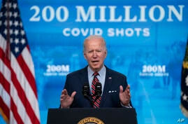 President Joe Biden speaks about COVID-19 vaccinations at the White House, Wednesday, April 21, 2021, in Washington. (AP Photo…