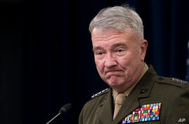 Gen. Kenneth McKenzie, Jr., commander of the United States Central Command, speaks during a briefing at the Pentagon in…