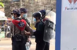 FILE - In this file image made from video taken on Feb. 27, 2021, Associated Press journalist Thein Zaw is arrested by police…
