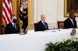 From left, Secretary of State Antony Blinken, President Joe Biden and Secretary of Defense Lloyd Austin attend a Cabinet…