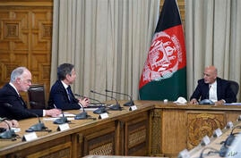 Afghan President Ashraf Ghani, right, meets with U.S. Secretary of State Antony Blinken, second left, and their delegations, at…