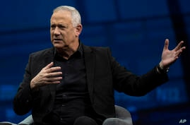 Israeli politician Benny Gantz gestures as he speaks during a conference in Jerusalem, Sunday, March 7, 2021. (AP Photo…