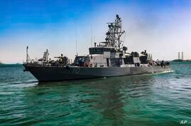 FILE - This April 14, 2020, file photo provided by the U.S. Army shows the USS Firebolt in Manama, Bahrain. The Firebolt fired…