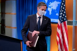 Secretary of State Antony Blinken arrives to announce the annual International Religious Freedom Report at a news conference at…