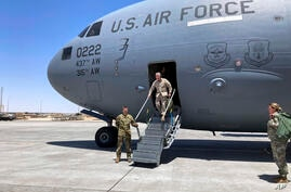 In this Thursday, May 20, 20201, photo Marine Gen. Frank McKenzie, the top U.S. commander for the Middle East, arrives in…
