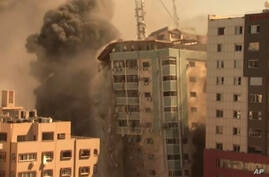 A building housing various international media, including The Associated Press, collapses after an Israeli airstrike on…