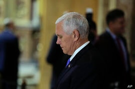 U.S. Vice President Mike Pence bows his head at the altar of the Buenos Aires Metropolitan Cathedral, Argentina, Tuesday, Aug…