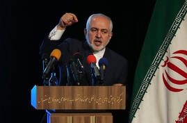 Iran's Foreign Minister Mohammad Javad Zarif addresses in a conference in Tehran, Iran, Tuesday, Feb. 23, 2021.  Following the…