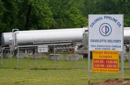 Tanker trucks are parked near the entrance of Colonial Pipeline Company Wednesday, May 12, 2021, in Charlotte, N.C.  The…