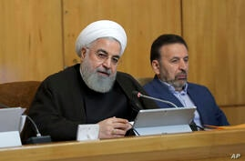 In this photo released by the official website of the office of the Iranian Presidency, President Hassan Rouhani speaks during…