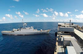 In this photo released Thursday, June 10, 2021, by the Iranian army, Iranian warships seen in the Atlantic Ocean. Iran has…