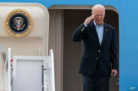 President Joe Biden salutes as he boards Air Force One upon departure, Wednesday, June 9, 2021, at Andrews Air Force Base, Md…