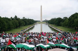 With the Washington Monument in the background, supporters of the Palestinians rally during the National March for Palestine…